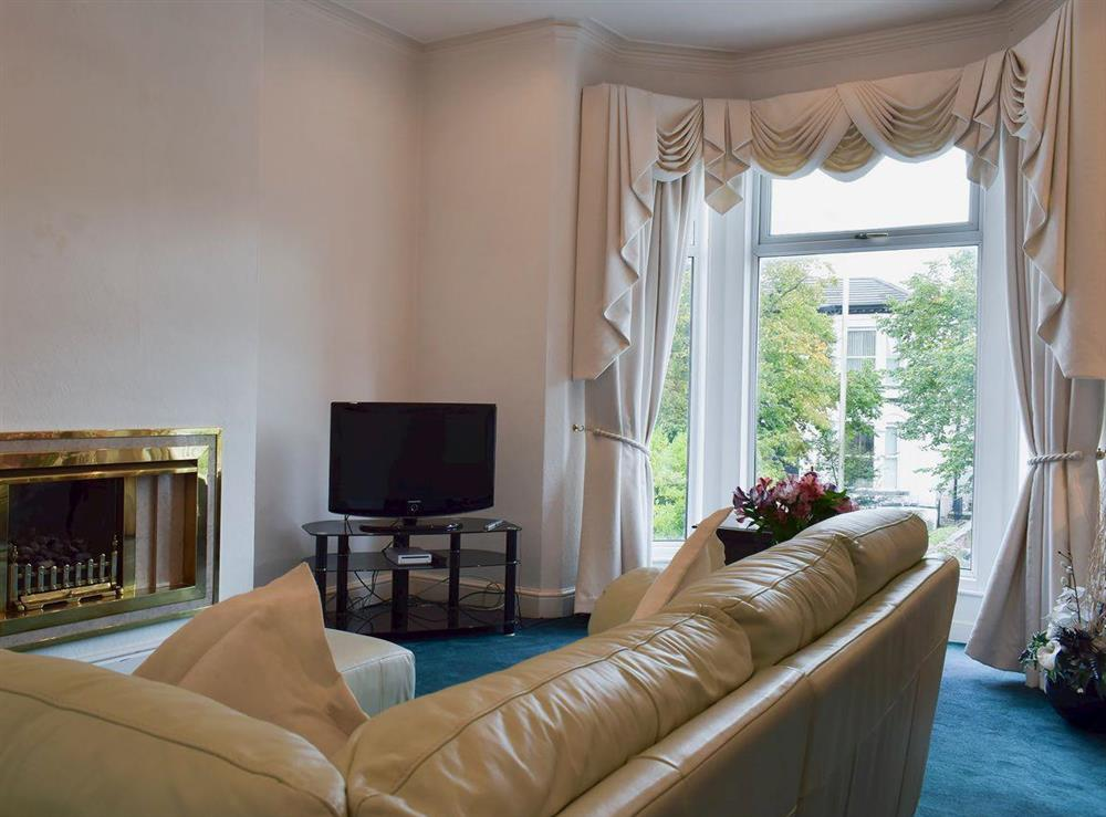 Spacious living room with beautiful bay window at Ash Villas in Southport, Merseyside