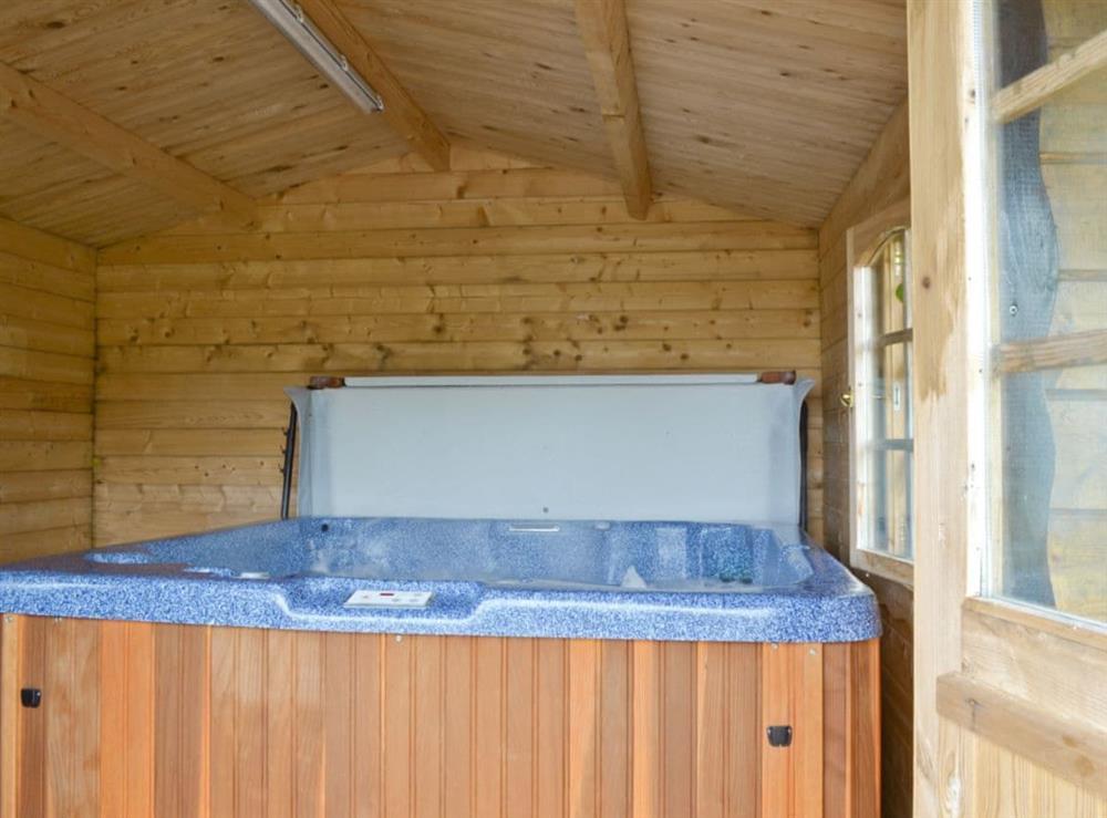 Hot tub at Ashknowe Log Cabin in Perth, Perthshire
