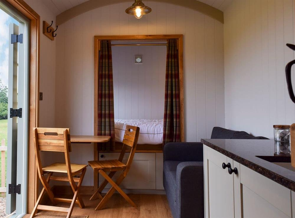 Open plan living space at Astwell Mill Shepherds Hut in Helmdon, near Brackley, Northamptonshire