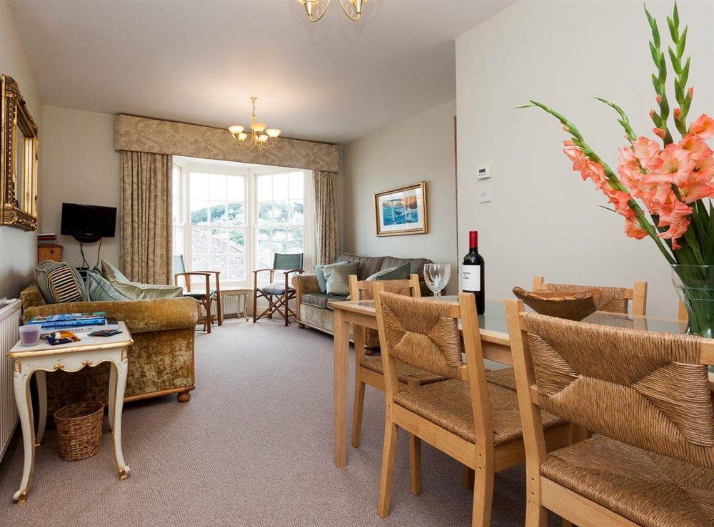 Living and dining room with superb river views at At Last in Dartmouth, Devon