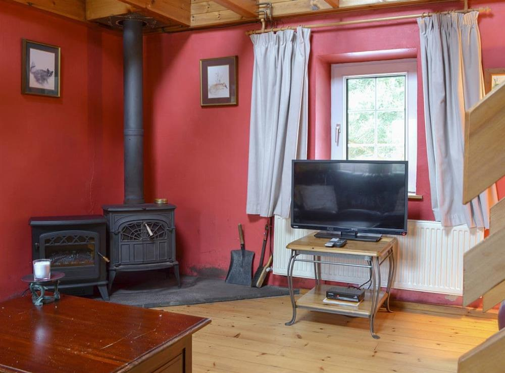 Living area at Woodpecker Cottage,