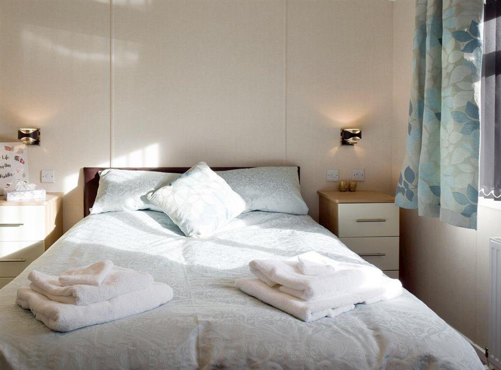 Relaxing double bedroom with en-suite bathroom at Azure View in Corton, near Lowestoft, Suffolk