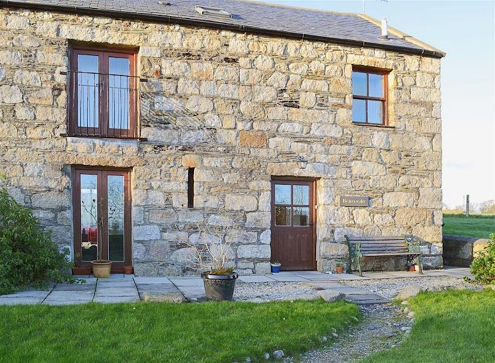 One of a pair of sympathetic barn conversions on the scenic Isle of Man