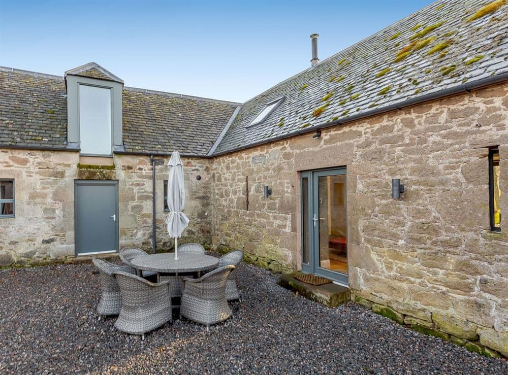Main entrance and gravelled patio area at Balmacaan Steading in Cawdor, near Nairn, Morayshire
