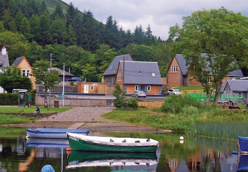 Boats on the loch next to Balmaha Lodges at Balmaha Lodges in Balmaha, Loch Lomond