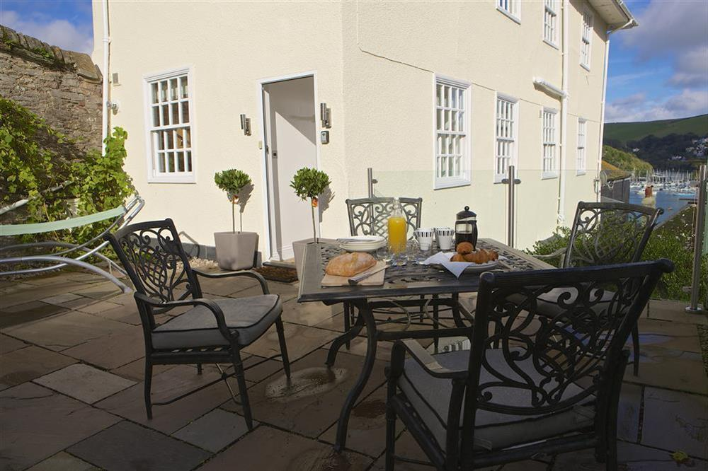 Enjoy the sunny patio with glimpses of the River Dart