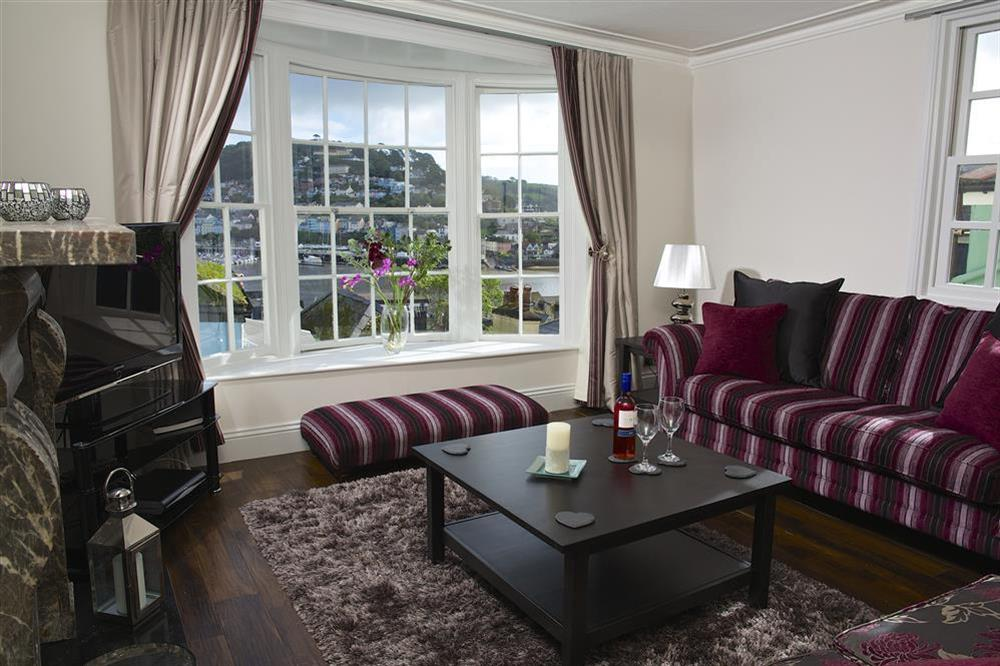 Lounge with bay window to take in the view at Balmoral House in , Dartmouth