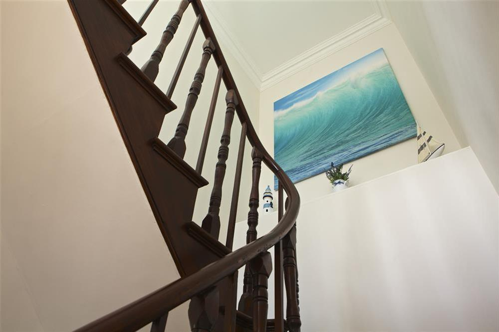 Upstairs leads to the en suite bedrooms at Balmoral House in , Dartmouth