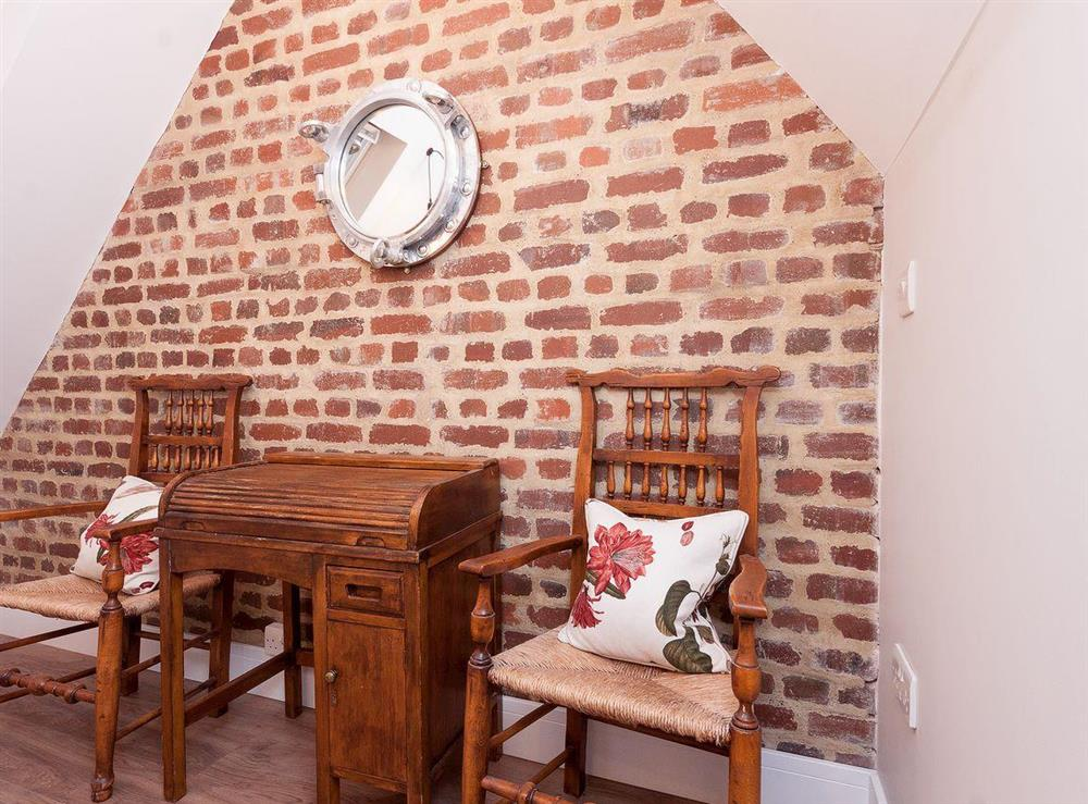 Landing with exposed brickwork and peaceful sitting area