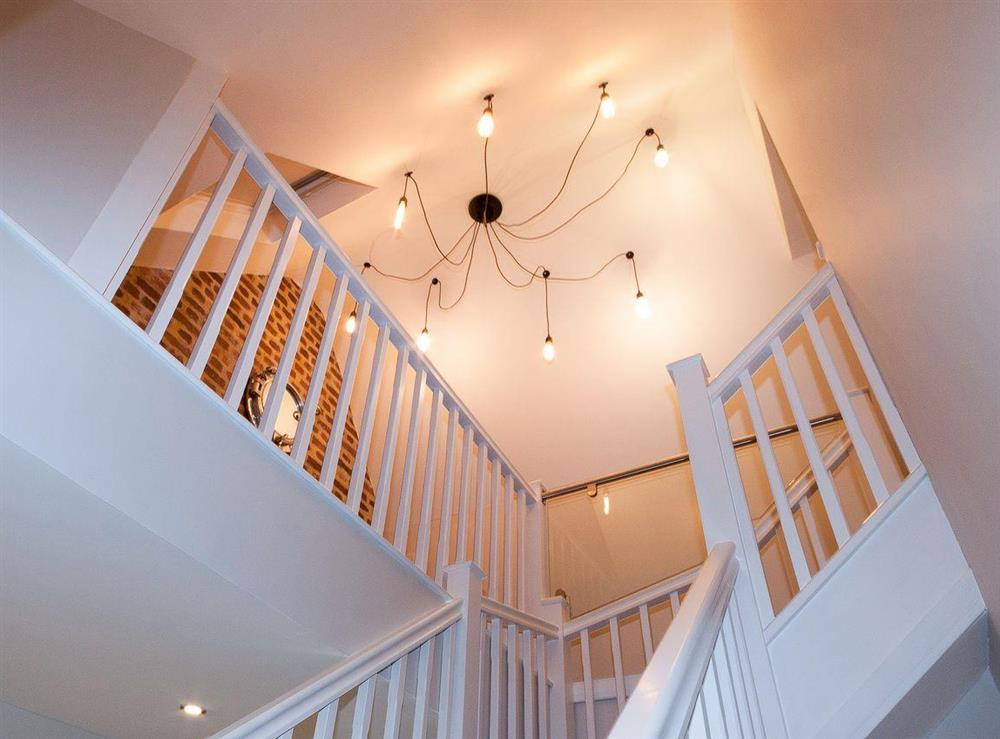 Spacious stairwell with contemporary lighting