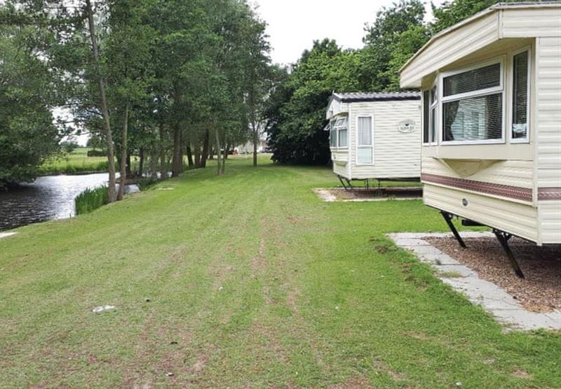 Setting, by the river, of the Cosalt Caravan at Barlings Country Park in Langworth, Lincolnshire