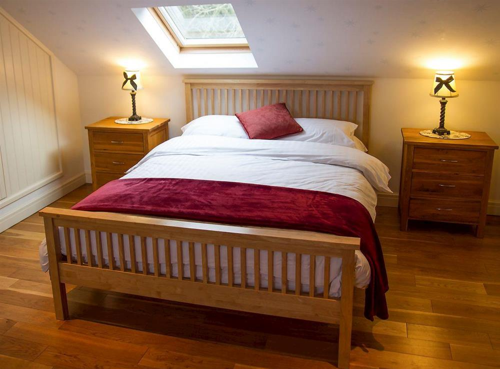 Bedroom at Woodpecker Cottage,