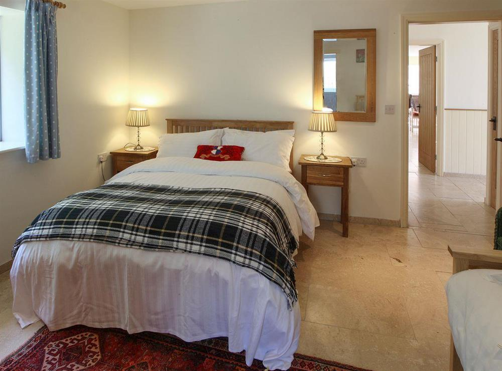 Comfortable bedroom at Woodpecker Cottage,
