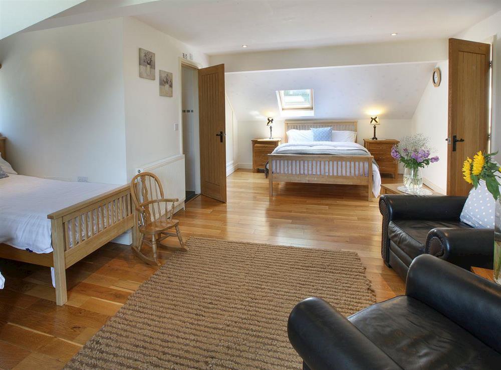 Large bedroom at Woodpecker Cottage,