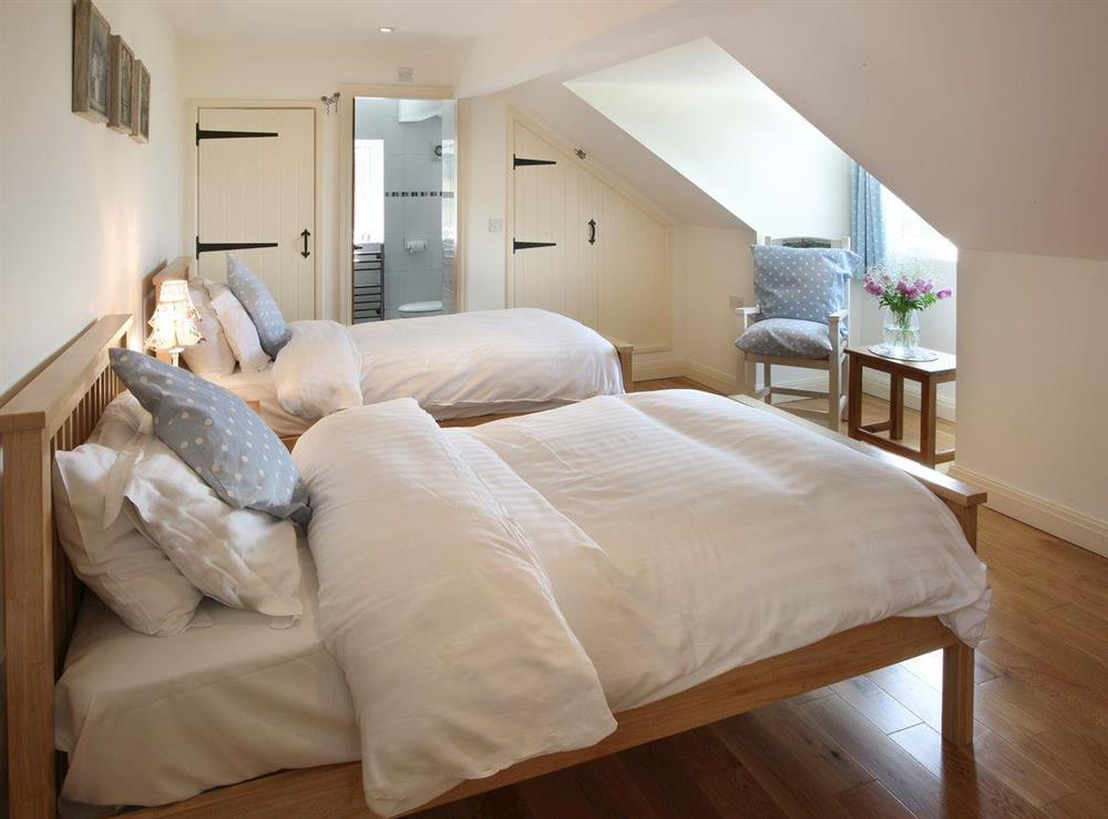 Peaceful twin bedroom at Woodpecker Cottage,