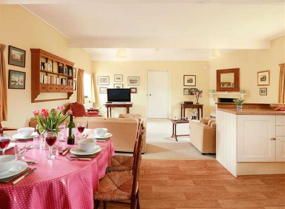 Spacious open plan living area with lovely dining table at Barningham Hall Stable in Matlaske, near Sheringham, Norfolk