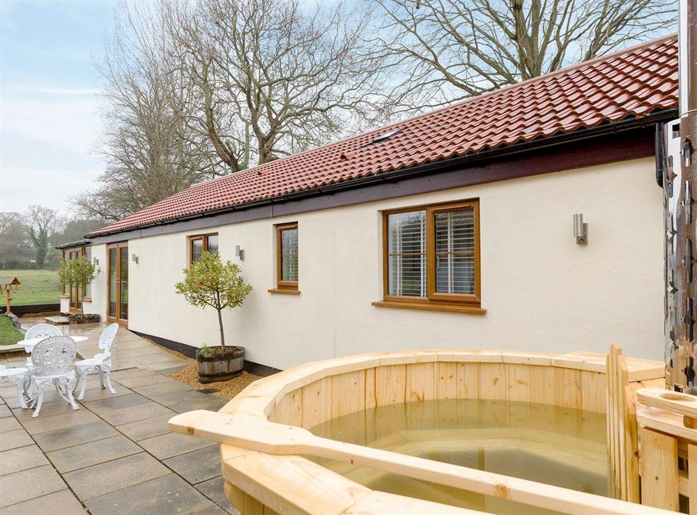 Relaxing private wood-fired hot tub at Bay Cottage in Boughton, near Downham Market, Norfolk