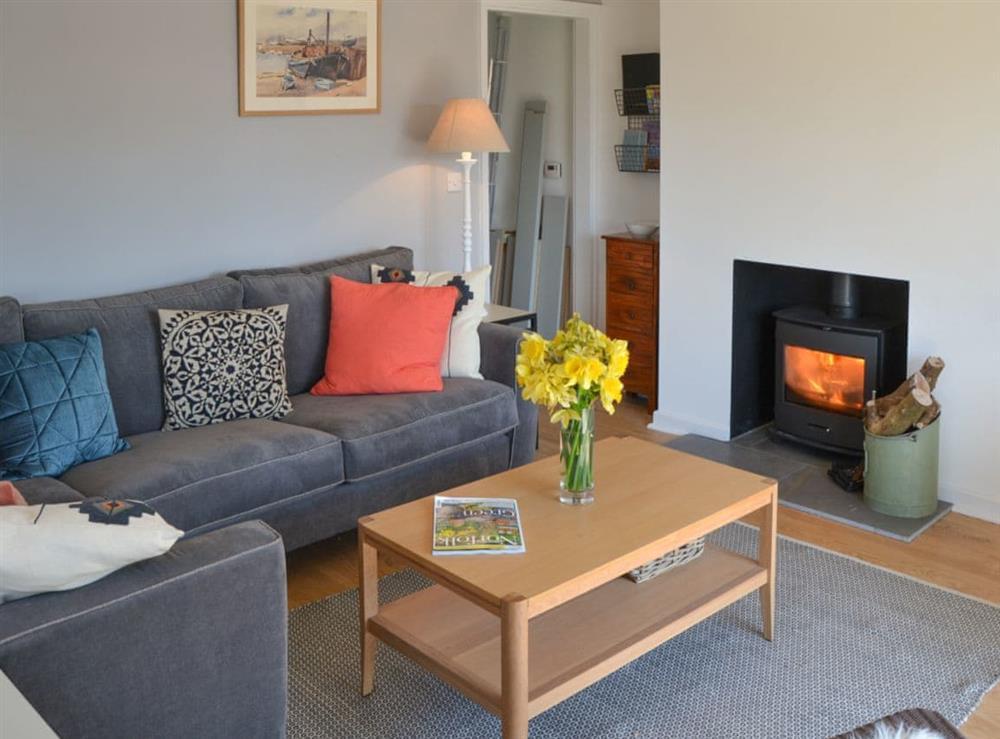 Living room with wood burner at Beach Haven in Sheringham, Norfolk