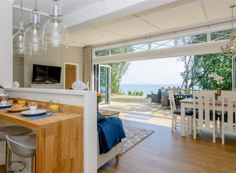 Open plan living space with bi-folding doors at Beach Retreat in Corton, near Lowestoft, Suffolk