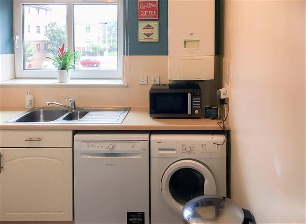 Kitchen with laundry facilities at Beachside in Ayr, Ayrshire