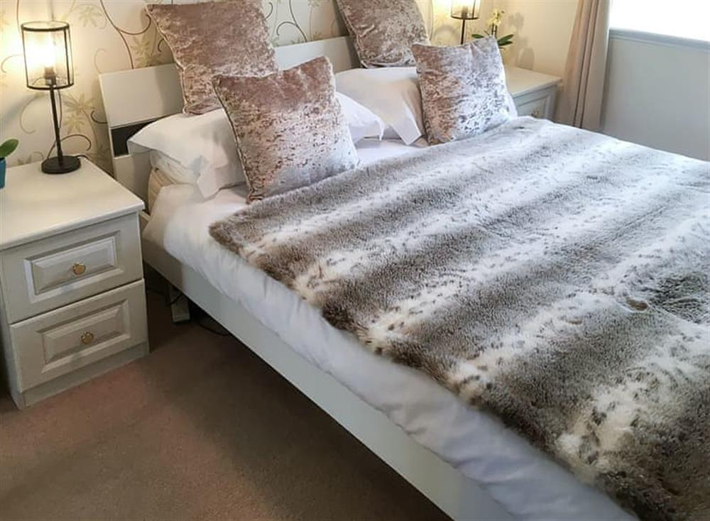 Stylish bedroom with double bed at Beachside in Ayr, Ayrshire