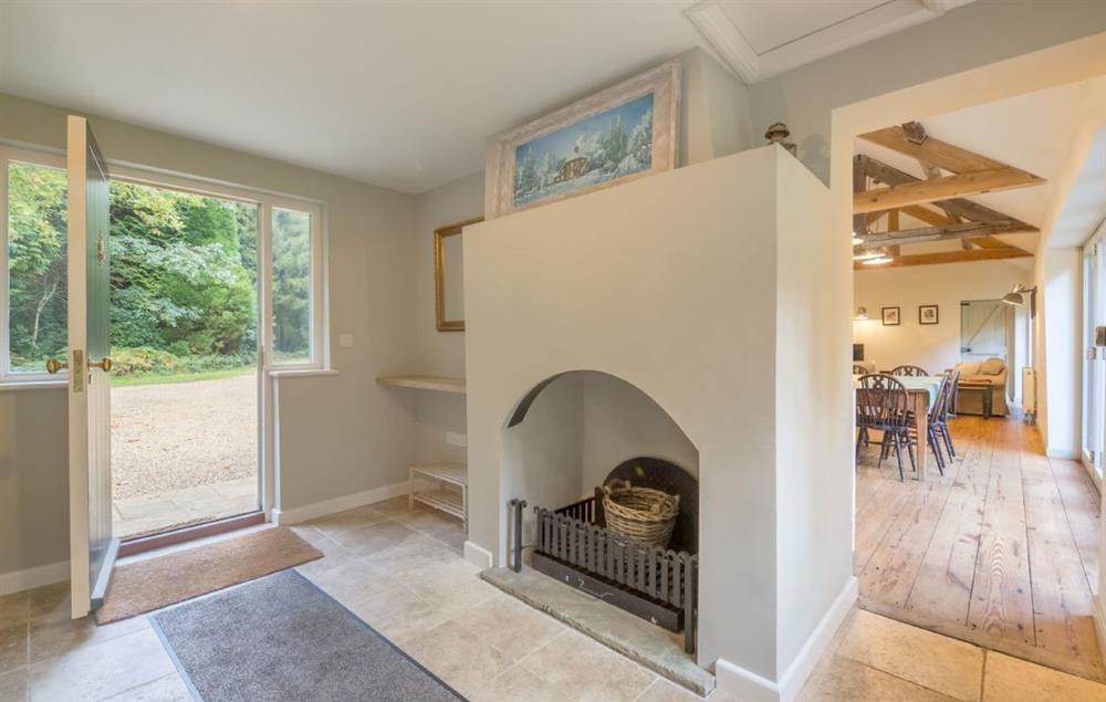 Ground floor: Entrance hall with tiled floor and decorative fire place