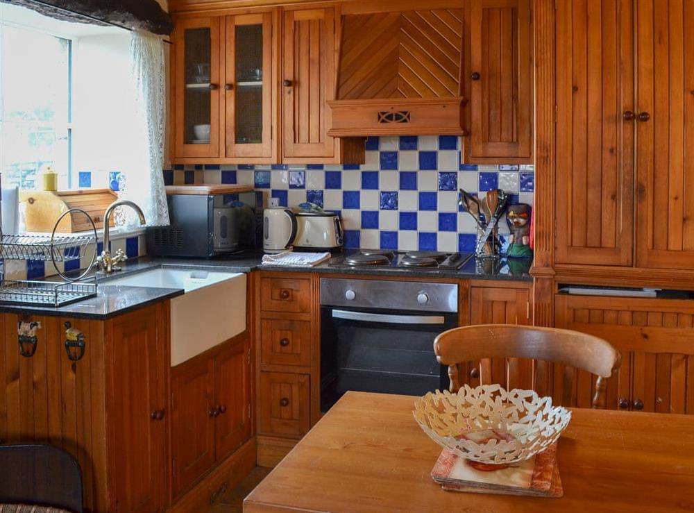 Beautiful fitted kitchen with dining area at Stable Cottage,