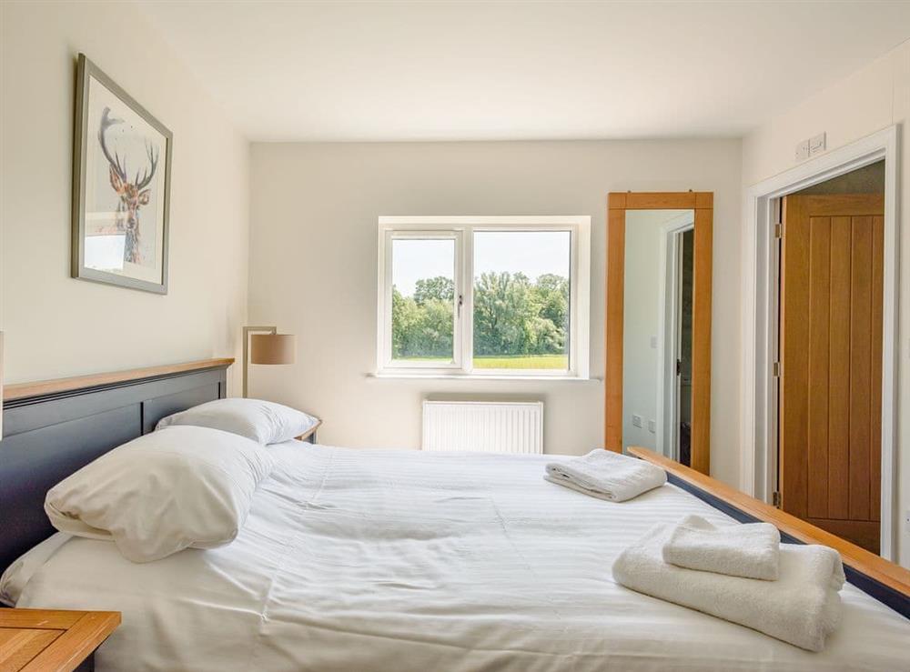 Double bedroom (photo 3) at Alderfen Barn,