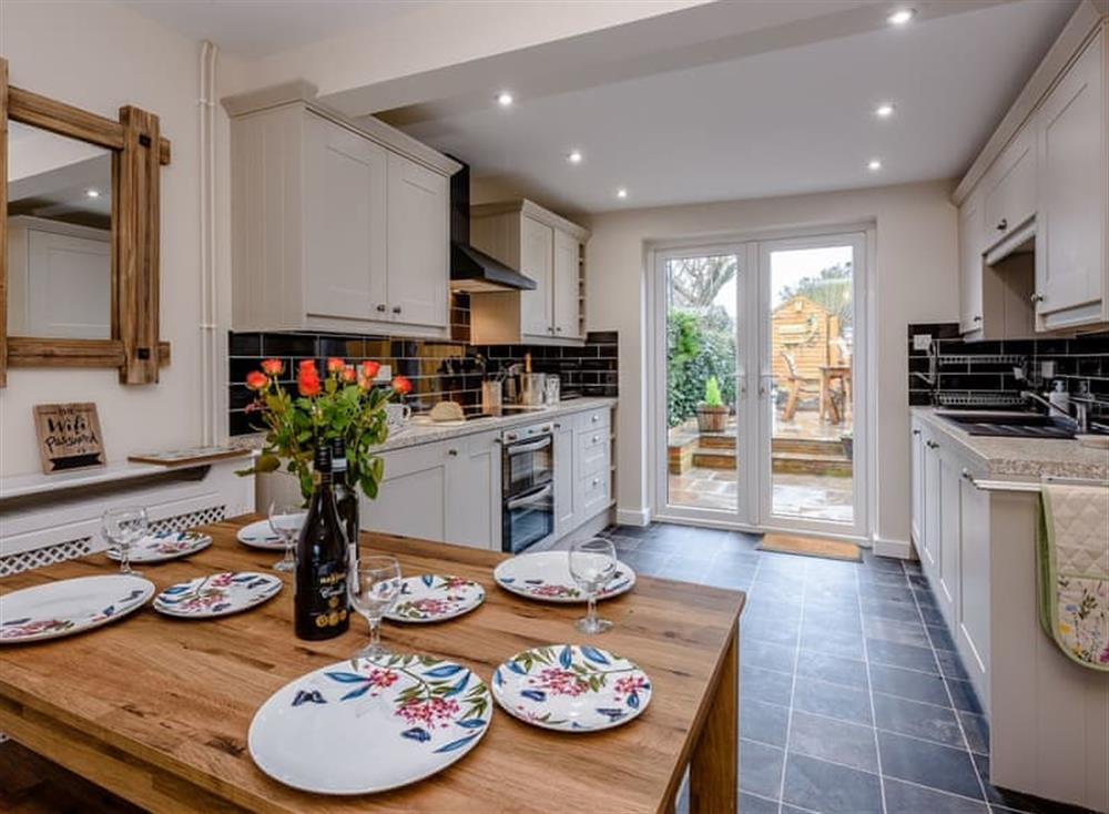 Kitchen and dining area at Beech Tree Cottage in Horning, near Wroxham, Norfolk