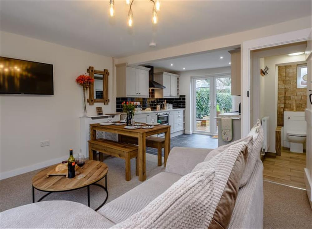 Open plan living space at Beech Tree Cottage in Horning, near Wroxham, Norfolk