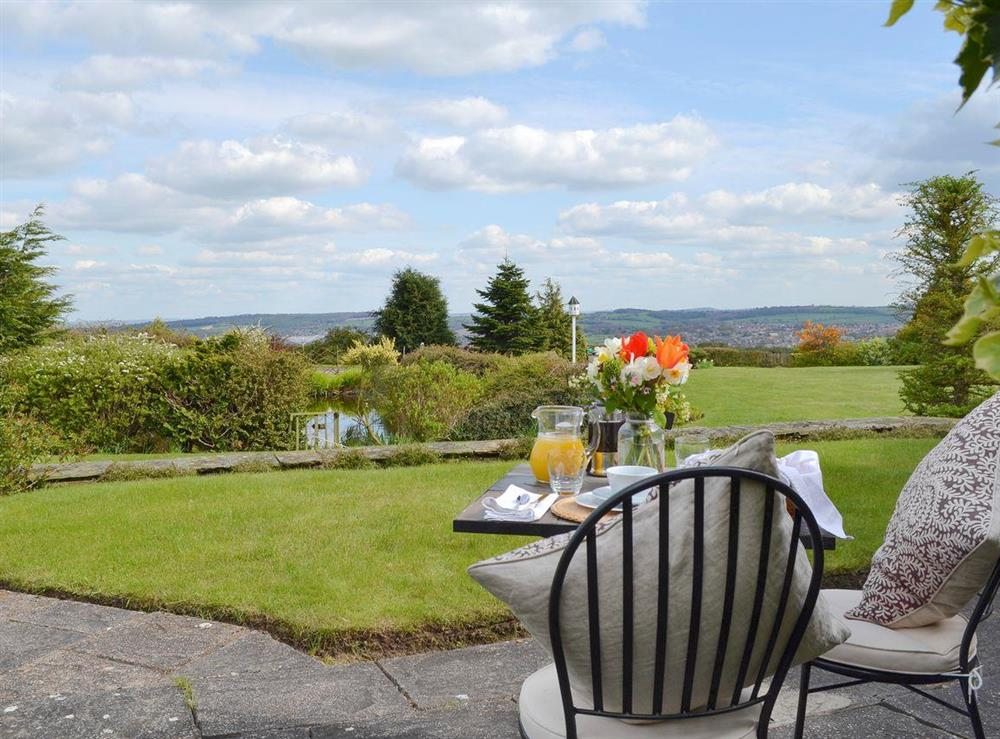 Splendid view over the garden from the patio at Bellhouse Croft in Shelley, near Huddersfield, West Yorkshire