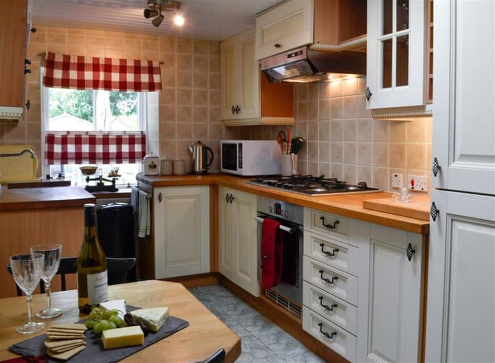 Kitchen with dining area at Belstane Cottage in Straiton, near Ayr, Ayrshire