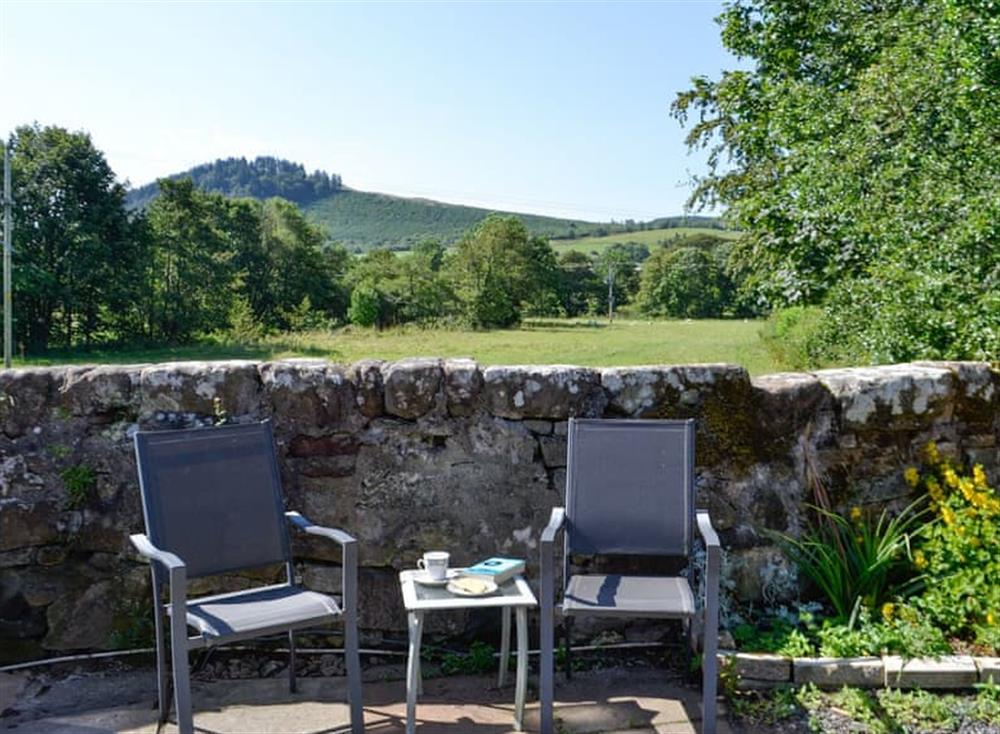 Sitting out area with great views at Belstane Cottage in Straiton, near Ayr, Ayrshire