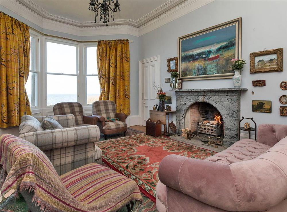 Living room with open fire (photo 2) at Bentfield in Prestwick, Ayrshire