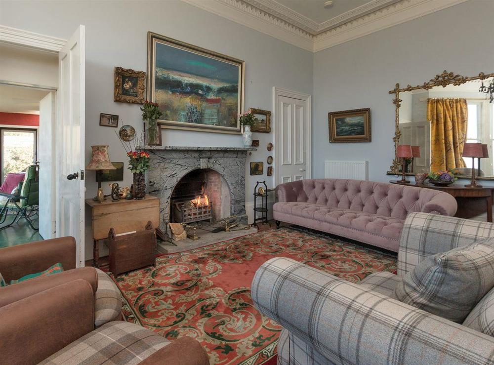 Living room with open fire at Bentfield in Prestwick, Ayrshire