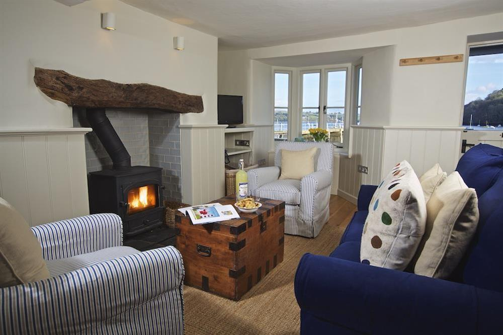Berry Cottage is an immaculately presented waterfront retreat overlooking the River Dart at Berry Cottage in , Dittisham