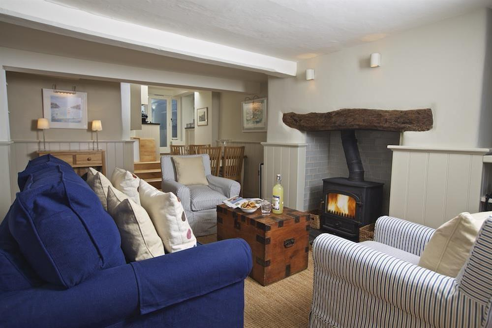 Charming, cosy living area with wood-burning stove at Berry Cottage in , Dittisham