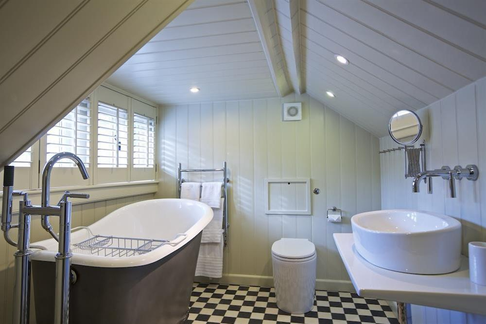 En suiite bathroom (accessed via narrow, steep stairs) at Berry Cottage in , Dittisham
