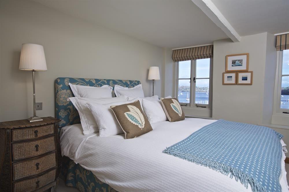 Master en suite bedroom with superb river views at Berry Cottage in , Dittisham