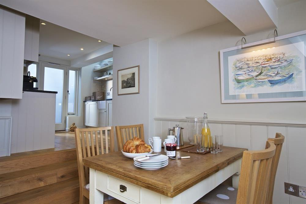 The dining area has an oak table and chairs at Berry Cottage in , Dittisham