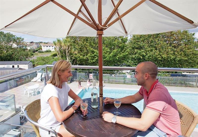 A drink by the pool at Beverley View in Paignton, South Devon