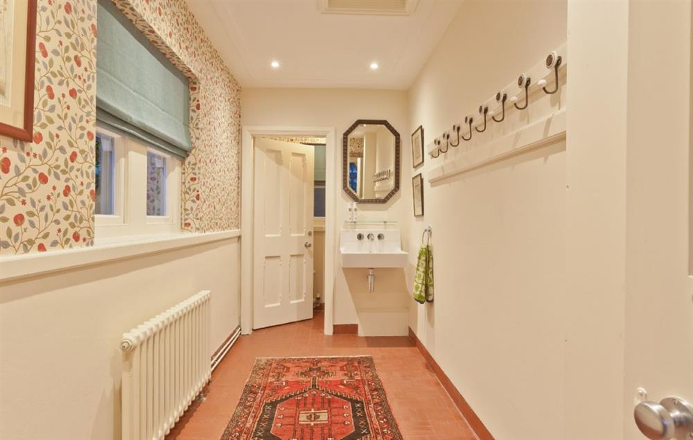 Ground floor: The bootroom with coat hooks and hand wash station