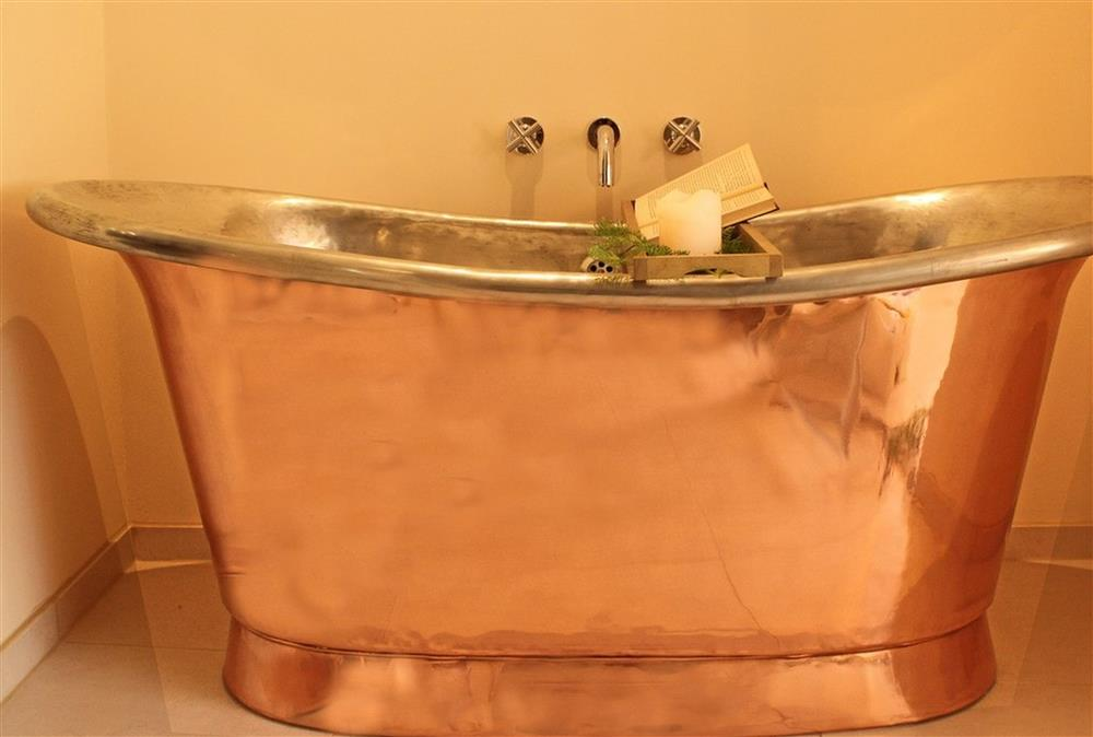 Relax in the luxurious, freestanding copper bath at Blacksmiths Cottage, Lavenham