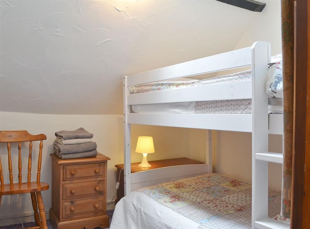 Bunk bedroom at Blacksmiths Cottage in Lound, near Gorleston, Suffolk