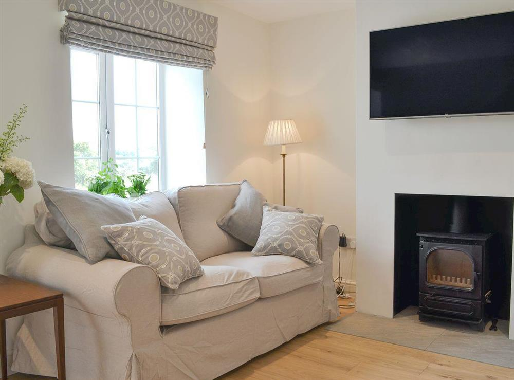 Homely living room with multi fuel burner at Bliss Cottage in North Creake, near Wells-next-the-Sea, Norfolk