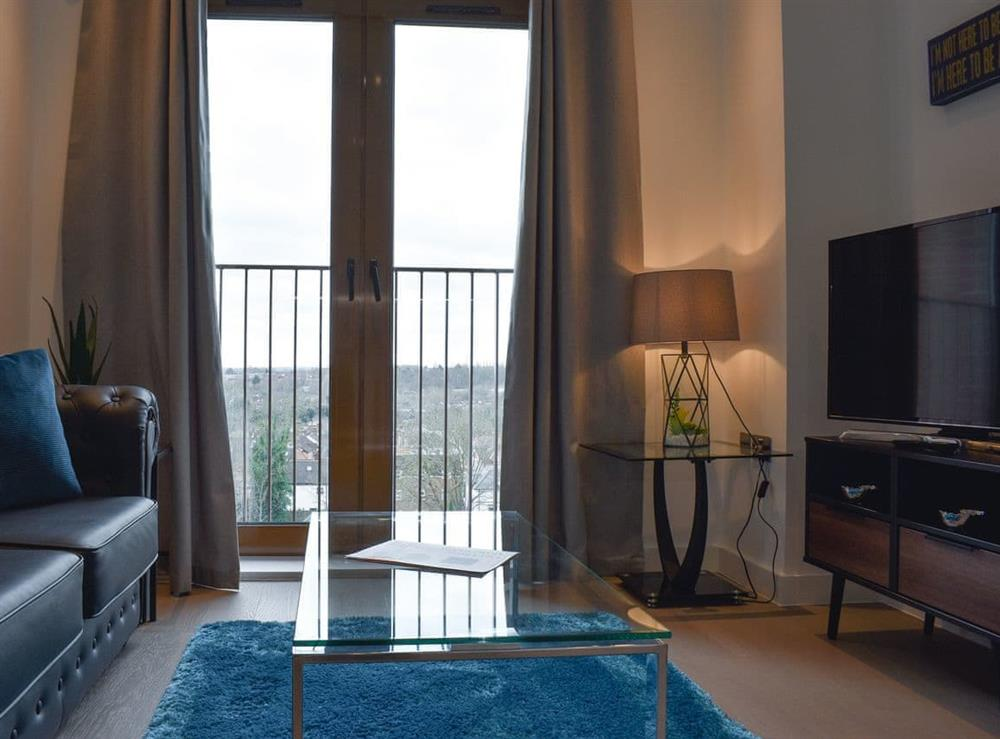 Open plan living space at Blue Rose Apartment in St Albans, Hertfordshire
