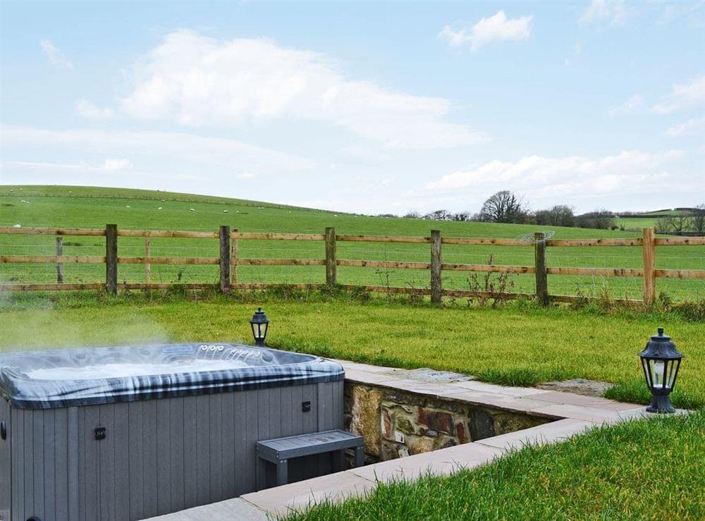 Relaxing, private hot tub at Bluebell Barn in Okehampton, Devon