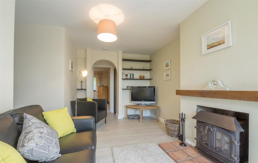 Ground floor: Cosy sitting room with a log burner