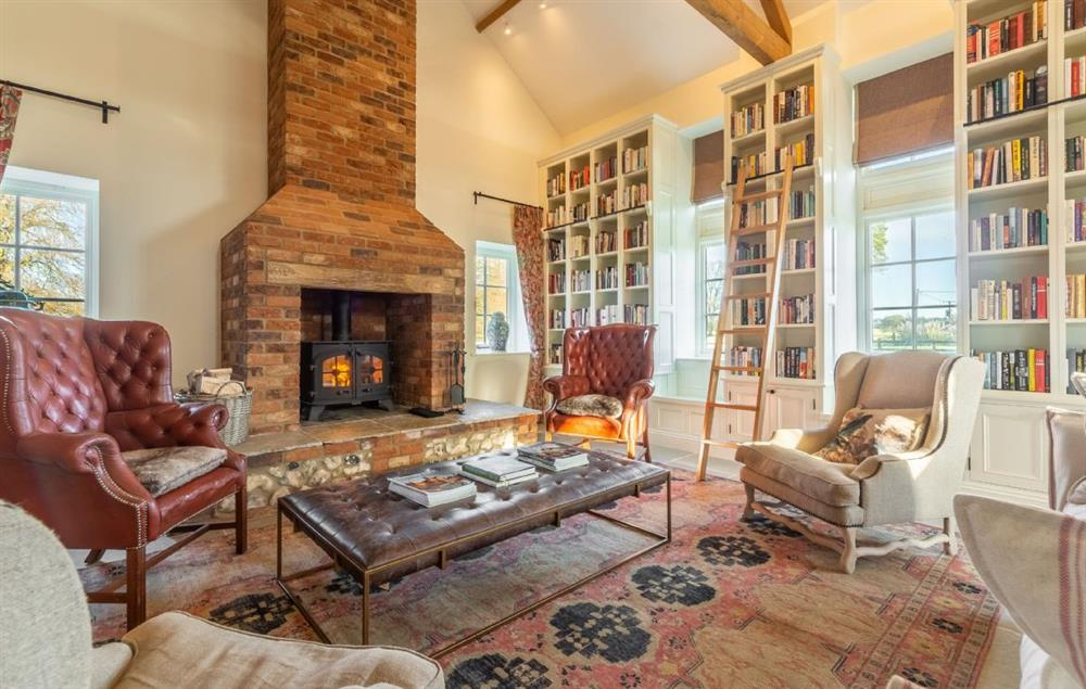Main Barn Ground Floor: Comfortable sitting room with wood burning stove and exposed beams