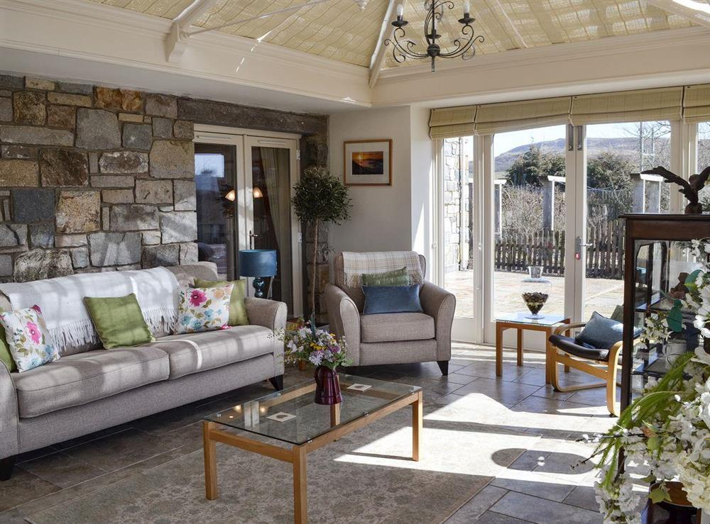Conservatory with relaxing seating area at Bodrydd,